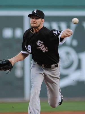 White Sox starting pitcher Chris Sale pitches during the first inning against the Red Sox at Fenway Park.