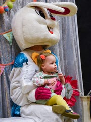 Families gathered around the Easter Bunny for photos during Eggstravaganza in March 2018 at the Sauk Rapids-Rice Middle School.