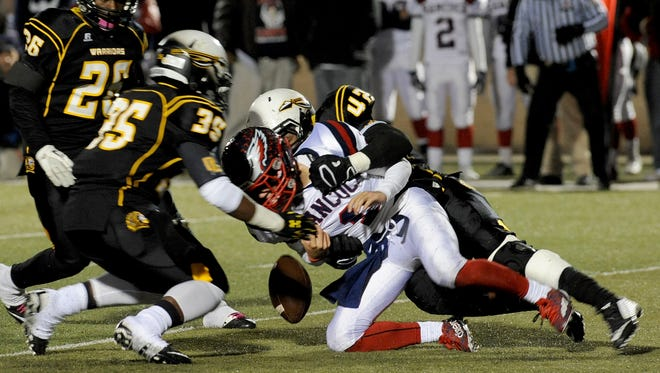 Oak Grove defensive player Deontae Haynes brings down Hancock quarterback Chase Fagan Friday night as the Warriors played their home game.