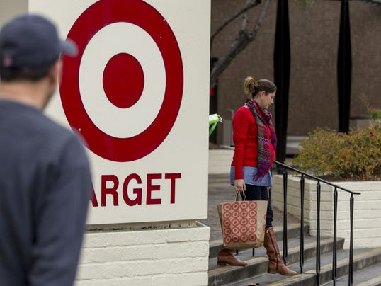 Shoppers walk past a Target store in Pasadena, Calif., on Thursday, Dec. 19, 2013. Target says that about 40 million credit and debit card accounts may have been affected by a data breach that occurred just as the holiday shopping season shifted into high gear.