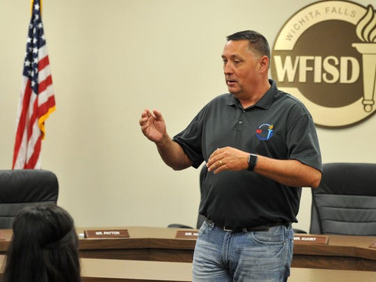 In this file photo, Wichita Falls Independent School District, Superintendent of School, Michael Kurhrt, spoke to a small crowd of students and parents shortly before a scholarship presentation held at the WFISD education center.