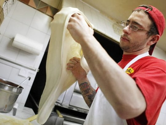 Joe Stasiak prepares pizza dough at Central Pizza in Red Lion. Made fresh daily, the restaurant is celebrating its 30th anniversary this year.