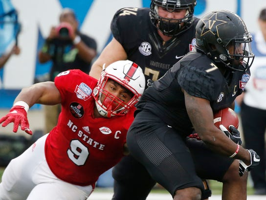 FILE - In this Dec. 26, 2016, file photo, North Carolina State defensive end Bradley Chubb (9) tackles Vanderbilt running back Ralph Webb (7) in the first half of the Camping World Independence Bowl NCAA college football game in Shreveport, La. Chubb believes there's an art to pass rushing, that it's more than just running to the quarterback. (AP Photo/Rogelio V. Solis, File)