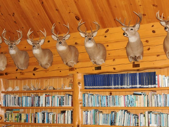 A wall of big-buck mounts spark memories and many tales of successful hunts.