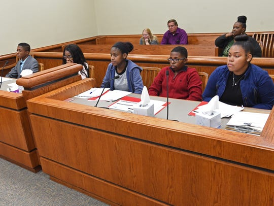 Master jurors listen to the evidence during a trial