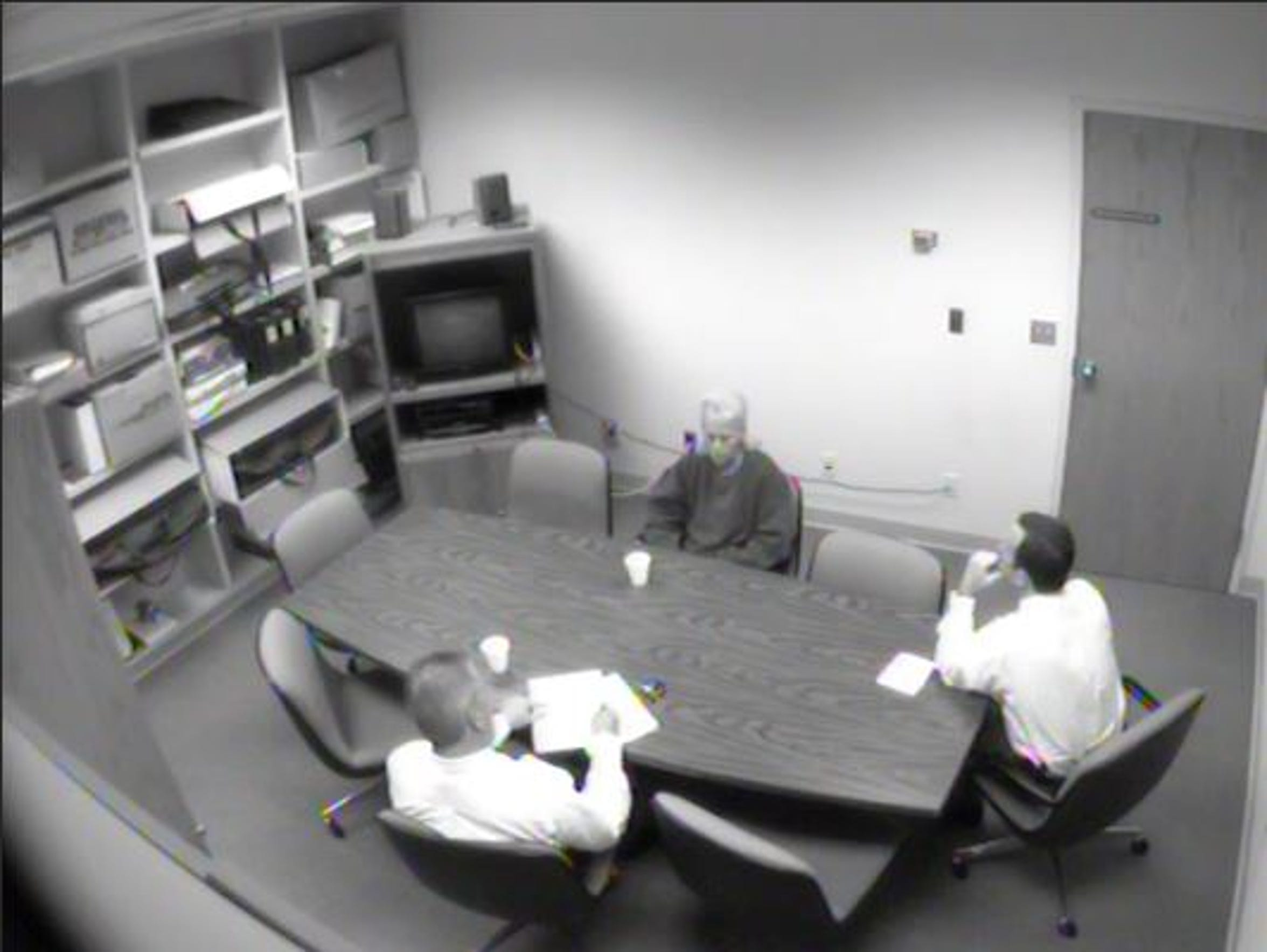 Dianna Siveny is interviewed by officers during the