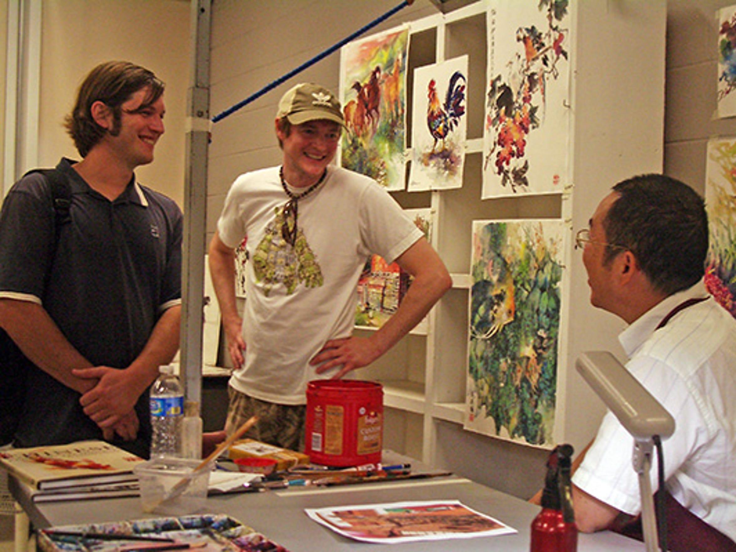 Lian Zahn,  (far right) of California, here to give