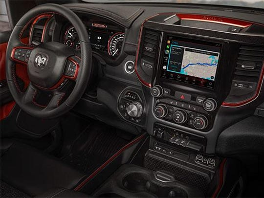 The interior of the 2019 Ram 1500 Rebel is outfitted for a sporty, off-road look.