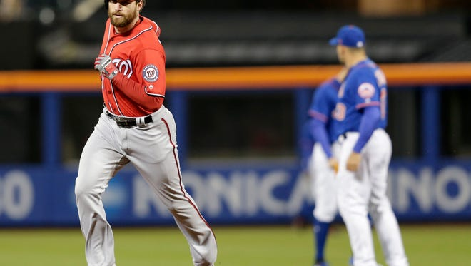 The Nationals' Daniel Murphy rounds the bases after hitting a grand slam during the first inning at Citi Field on Sunday.