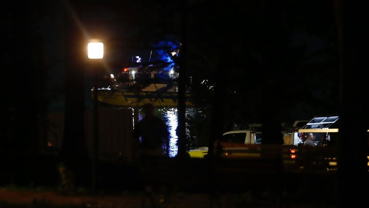 Rescue boats use spotlights in the water July 19, 2018,