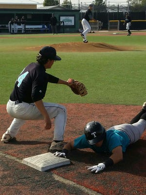 El Paso Community College outfielder Gerardo Balderrama dives back to first base before Marco Perea can put a tag on him. The Tejanos finished their fall season this weekend.