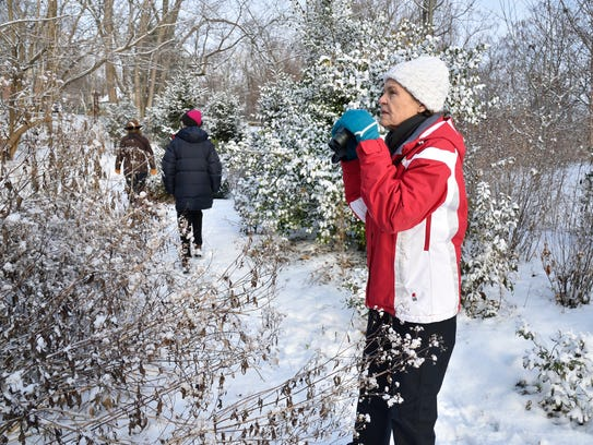 Linley Mahon of Ridgewood looks for birds at the annual