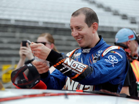 Sprint Cup Series driver Kyle Busch (18) waits for start of qualifications for the Brickyard 400 NASCAR auto race at Indianapolis Motor Speedway in Indianapolis, Saturday, July 23, 2016. (AP Photo/Darron Cummings)