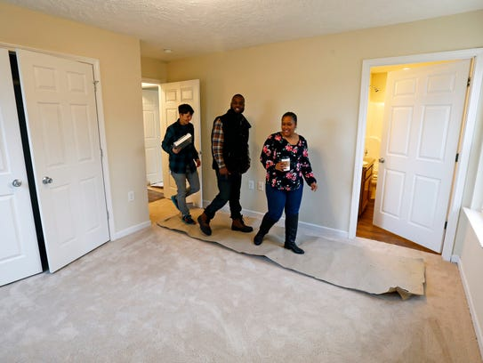 Tasha Towry with Habitat for Humanity, left, enters