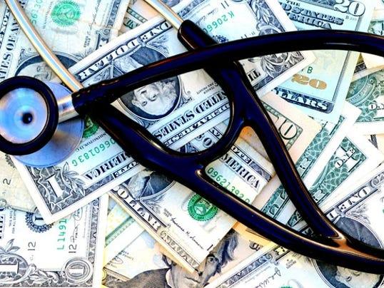 stethoscope-on-top-of-money_large.jpg