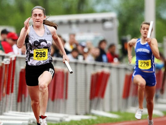South Western's Lynne Mooradian anchors the Mustangs' winning Class AAA 400 relay during the District 3 Track and Field Championships at Shippensburg University. (DAILY RECORD/SUNDAY NEWS -- FILE)