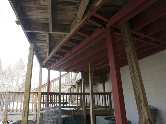 The Hartwigs deck was built over an existing deck at the home. The underside of the original deck and the newer deck are shown at their Wausau home, Thursday, March 12, 2015.