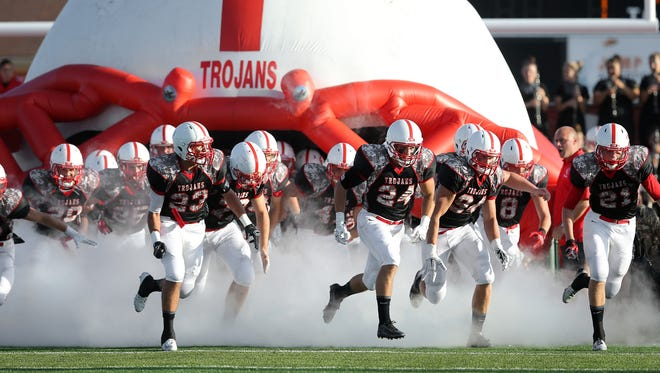 The Center Grove football team take the field for their season opener against Warren Central held at Center Grove High School on Friday, August 22, 2014.