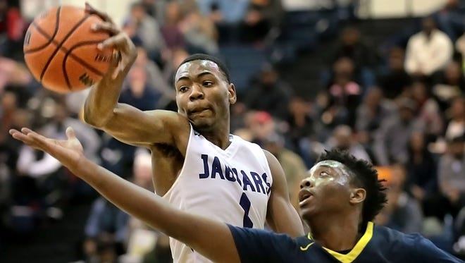 Southwind's Robert Boyd (1)  rebounds under pressure by Schyler Forest (right) from Lausanne during their game Saturday afternoon at the Penny Hardaway Hoopfest in Arlington.