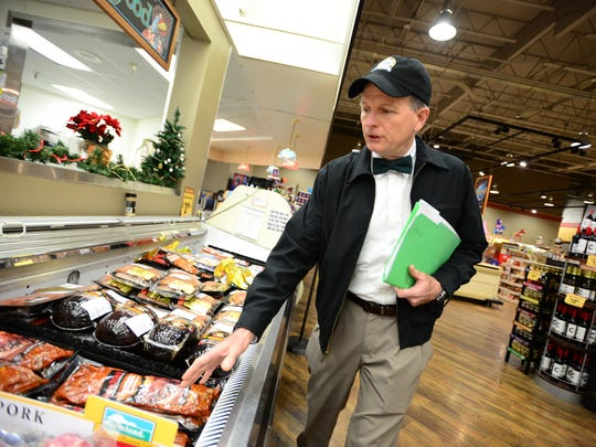 Peter McPartlin, Roth's meat and seafood director, explains some of the ways they ensure food safety at the Hayesville RothÕs Fresh Markets on Monday, Dec. 1, 2014.