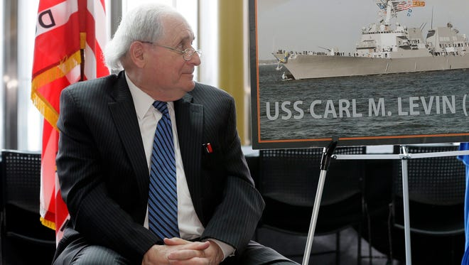 Former U.S. Sen. Carl Levin watches during the unveiling of a photo of the USS Carl M. Levin during a ceremony April 11, 2016, in Detroit. Naval officials came to Michigan to officially announce that the former senator will have a destroyer named after him. The destroyer is part of the Arleigh Burke class and will be built at Bath Iron Works in Maine. It's expected to enter the fleet in 2020. The Detroit Democrat served in the Senate from 1979 to 2015 and also served as chair of the Senate's Armed Services Committee.