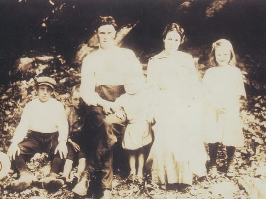 The Guthrie family in 1914. From left, Herman, Paul, James, Olsten, Bertha, Robbie and, on her mother's lap, Nora. Delmar Guthrie is not pictured.