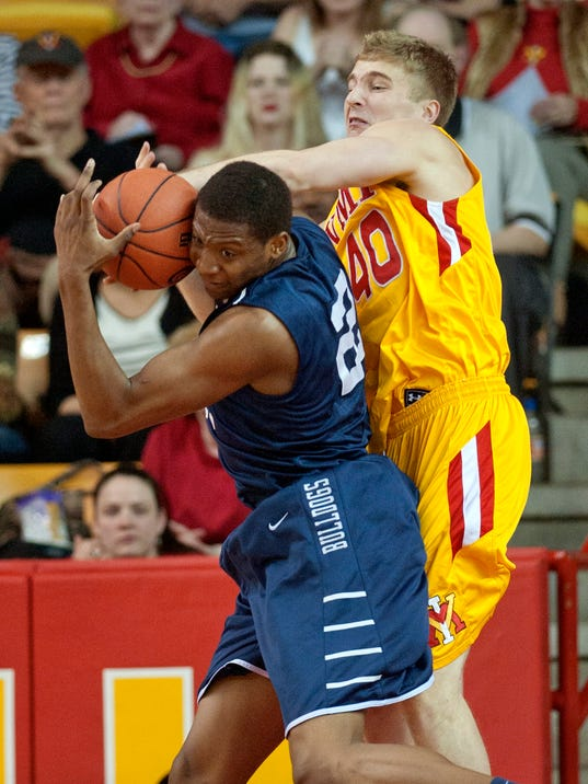 Virginia Military Institute's Jordan Weethee (40) battles against Yale's Justin Sears for a rebound during the first half of an NCAA CIT semi-final college basketball game at Cameron Hall, Tuesday, April 1, 2014, in Lexington, Va. (AP Photo/Don Petersen)