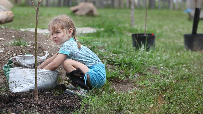 A child plays in a nature-play area at Head Start in this file photo.