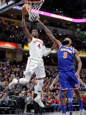 Indiana Pacers guard Victor Oladipo (4) shoots in front of New York Knicks center Kyle O'Quinn (9) during the second half of an NBA basketball game in Indianapolis, Sunday, Feb. 11, 2018.