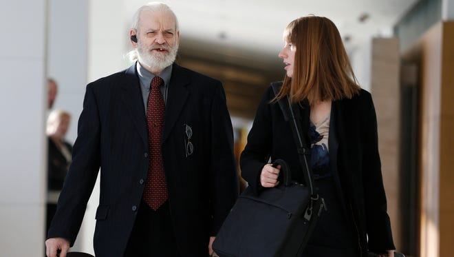 In this Nov. 15, 2013 file photo, Wayne Sperling, left, arrives at court with his public defender at the Denver Justice Center, in Denver. Sperling, a father whose four young sons could communicate only in grunts when authorities rescued them from a filthy Denver apartment, faces up to seven years in prison when he is sentenced Tuesday, Dec. 30, 2014.
