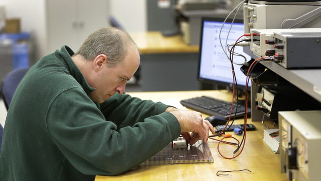 Dan Geiser of Brillion measures frequency by replacing resisters during a class Oct. 28 at Fox Valley Technical College in Grand Chute. Geiser has returned to school to further his education in manufacturing.