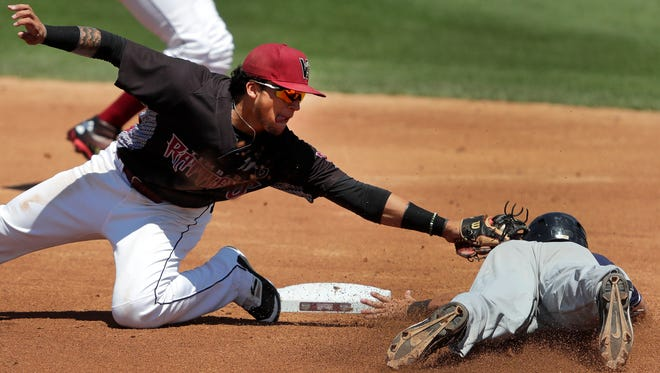 Timber RattlersÕ Isan Diaz tries to tag out Lake County CaptainsÕ Connor Marabell at second base during their game Monday, July 25, 2016 at Neuroscience Group Field in Grand Chute, Wis. Danny Damiani/USA TODAY NETWORK-Wisconsin