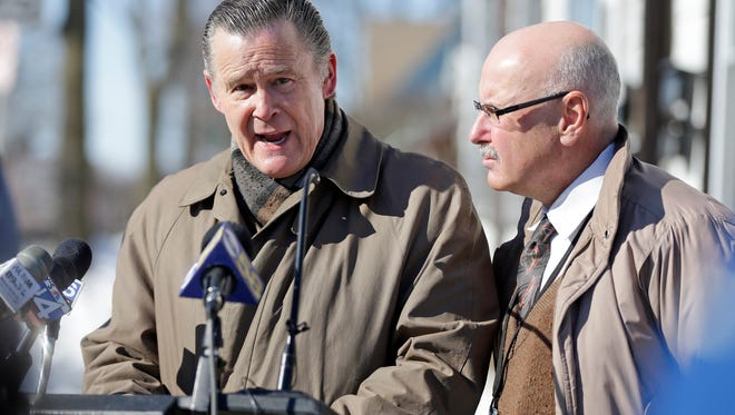 Aldermen Bob Donovan (left) and Mark Borkowski talk to reporters about car thefts during a 2016 news conference.