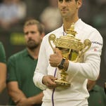 Novak Djokovic at the trophy presentation after winning his match against Roger Federer on day 13 of The Championships Wimbledon at the All-England Club.