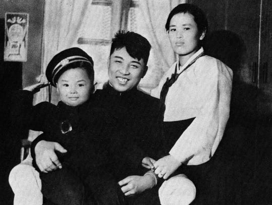 In this undated photo from North Korea's official Korean Central News Agency, distributed by Korea News Service, Kim Jong Il, left, is seen with his parents, Kim Jong Suk, right, and Kim II Sung.