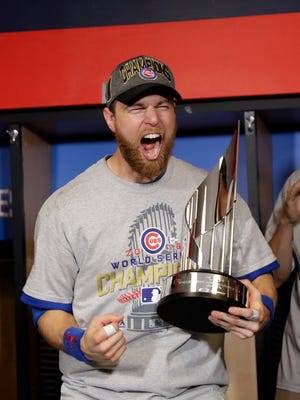 Chicago Cubs outfielder Ben Zobrist celebrates with the MVP trophy after game seven of the 2016 World Series against the Cleveland Indians at Progressive Field.