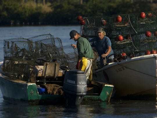 A pair of crabbers work the Caloosahatchee River.