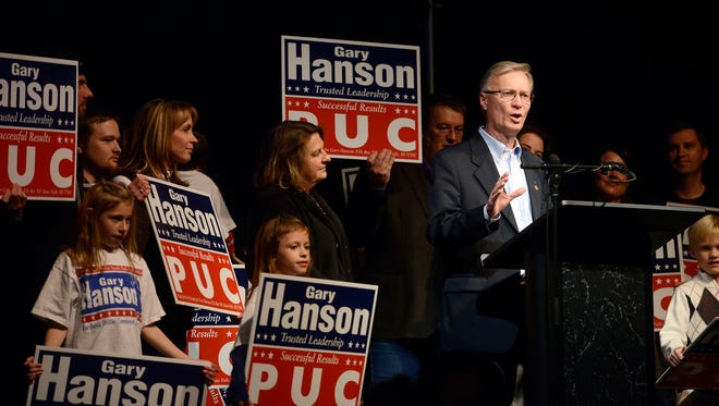 Gary Hanson celebrates winning another term as public utilities commissioner Tuesday at a Republican election night party at The District in Sioux Falls, Nov 4, 2014.