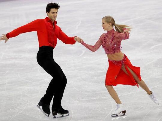 Kaitlyn Weaver and Andrew Poje (CAN) perform in the short dance event during the Pyeongchang 2018 Olympic Winter Games at Gangneung Ice Arena.