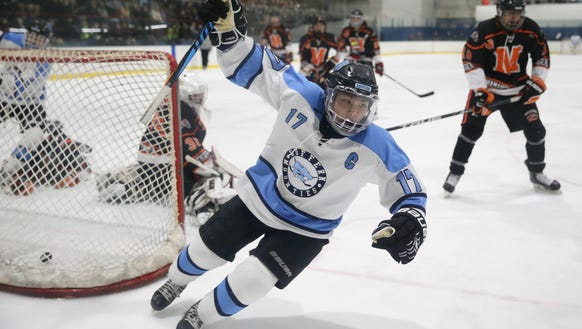 Suffern's Evan Cama (17) reacts after putting the puck