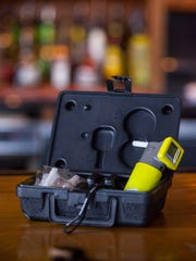 A breathalyzer sits on the counter at Toadz in Cedar