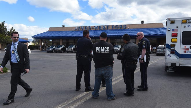 Various law enforcement officials are seen in the parking lot of the Jones-West Ford dealership in Reno on April 28, 2016.