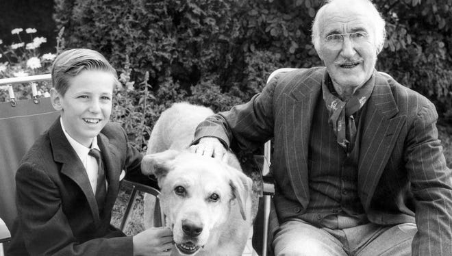 "David Ladd, left, and Donald Crisp with their co-star of ""Old Yeller."""