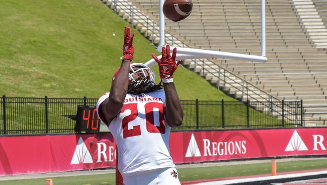 White wide receiver Jarrod Jackson catches a pass for a score during Saturday's spring football game at Cajun Field.