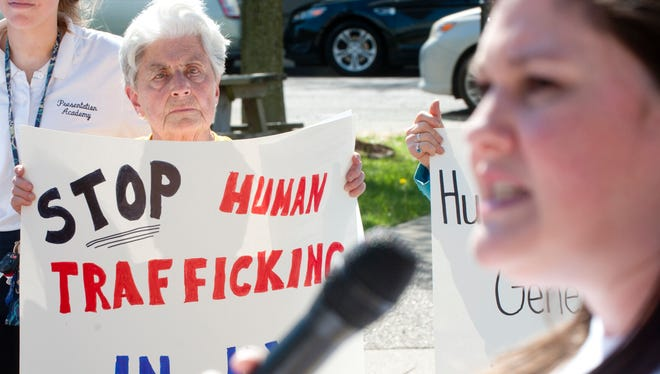 Sister Julie Driscoll of the Sisters of Charity Nazarene, listens to a speaker at a public prayer service and speak-out for victims of human trafficking held at Jefferson Square Park in downtown Louisville.May 1st, 2018