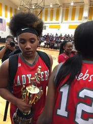 """North Caddo""""s Destiny Rice carries her MVP trophy after"""