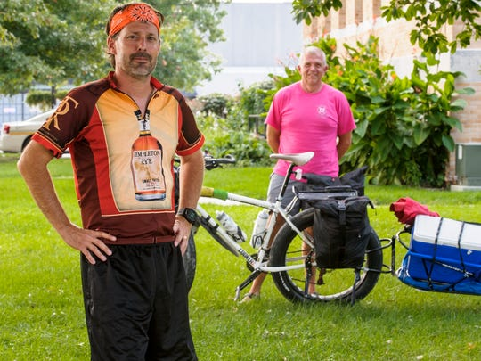Scott Mills is riding his bike across Iowa to raise money for St. Jude Children's Research Hospital. He is accompanied and supported on the road by Ames firefighter Steve Buser, who rides a bike that carries all their gear.