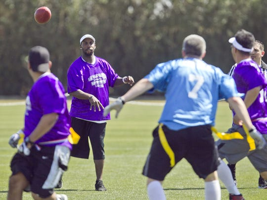 Anquan Boldin passes a ball during the Kurt Warner Ultimate Football Experience in 2012.