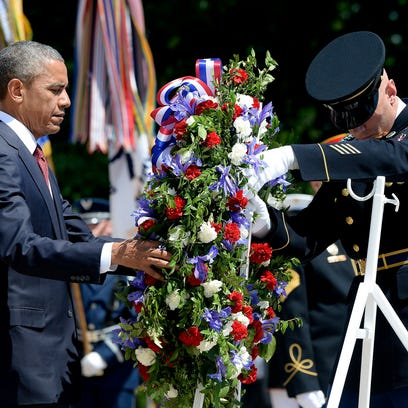 President Obama lays a wreath at the Tomb of the Unknowns