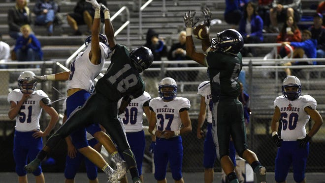 Damonte Ranch's Dru Jacobs (6) intercepts a pass intended for Reno's Will Barnard (9) during their football game on Friday, Sept, 18, 2015. Jacobs took the ball all the way for a touchdown on the play.